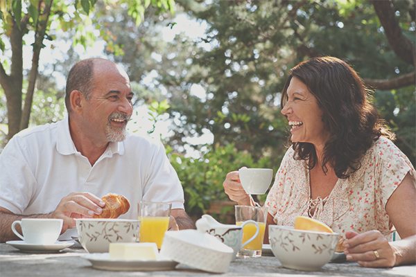 A man and woman having tea at a table